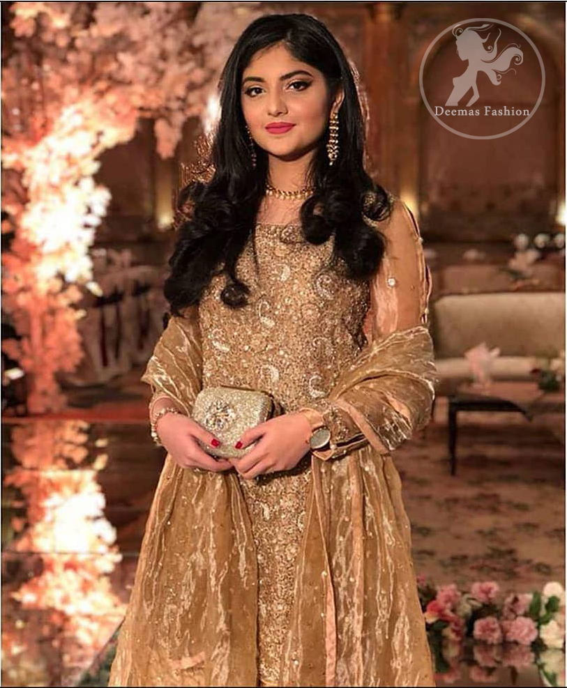 Take a step towards refreshing your wardrobe with this regal dress. The shirt is beautifully adorned with golden kora dabka, kundan, tilla and sequins work along net sleeves. The self-printed brocade sharara is enhanced with lace detail on bottom. It comes with organza dupatta sprinkled sequins on ground.